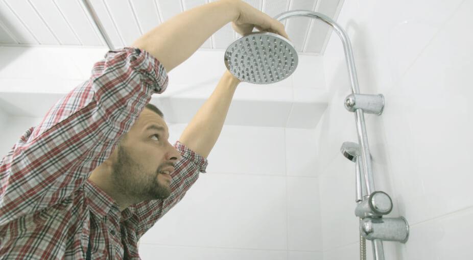 Man Replacing a Showerhead
